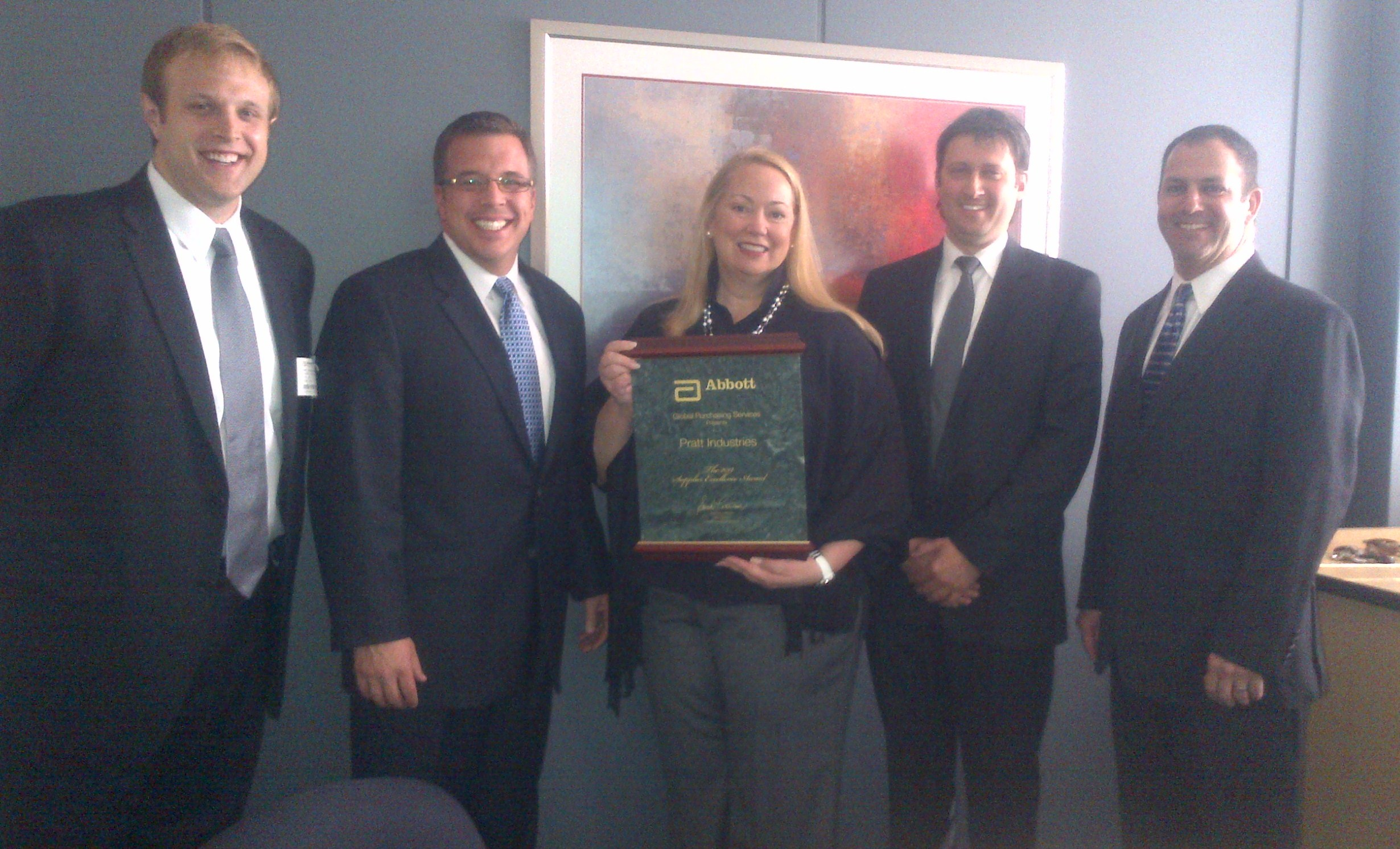 Sarah M. Catterson – Abbott's Vice President of Global Purchasing, presents Pratt Industries with the 2011 Supplier Excellence Award. Receiving on behalf of Pratt are (from left) Patrick Bengelink (Sales Rep), David Gill (Sales Manager, Grand Rapids), Craig Stucky (General Manager, Grand Rapids) and Richard Turner (Strategic Account Manager).