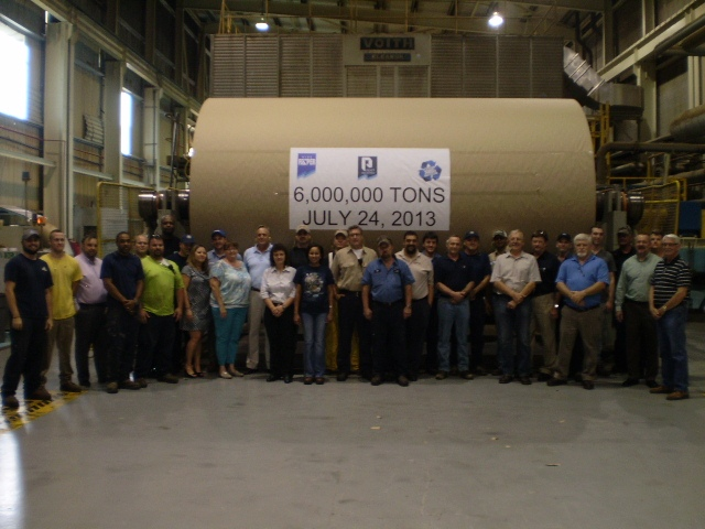 The team at Conyers celebrate the making of the mill's 6 millionth of 100% recycled paper.