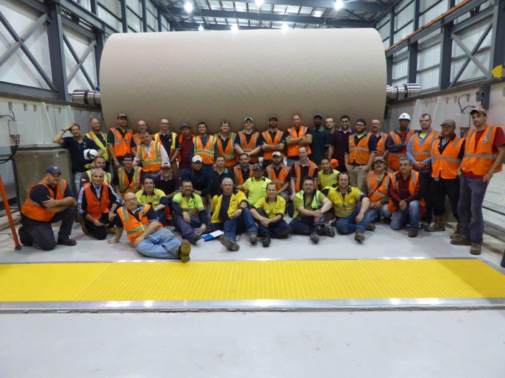 The hard-working Pratt team gathers in front of the first reel of paper to come off the new mill in Valparaiso.