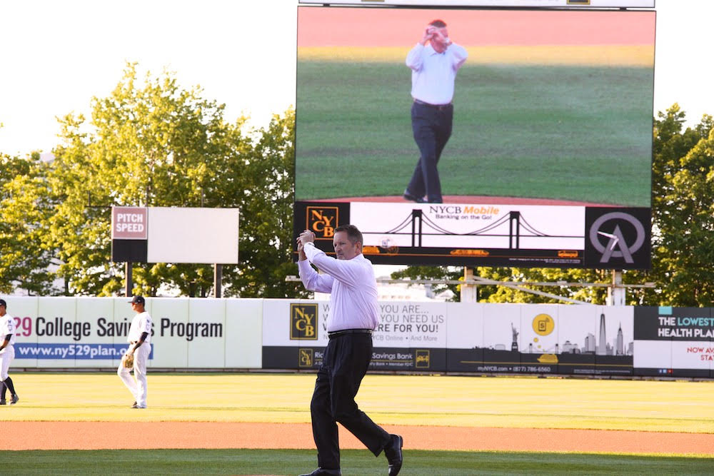 Pratt Industries COO David Dennis throws the first pitch of the Staten Island Yankees Game