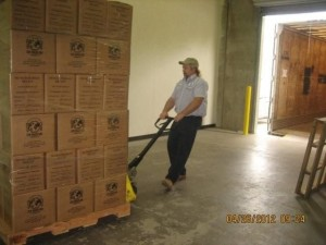 Pratt Industries Employee Mark Clement Loads Supplies for Stop Hunger Now
