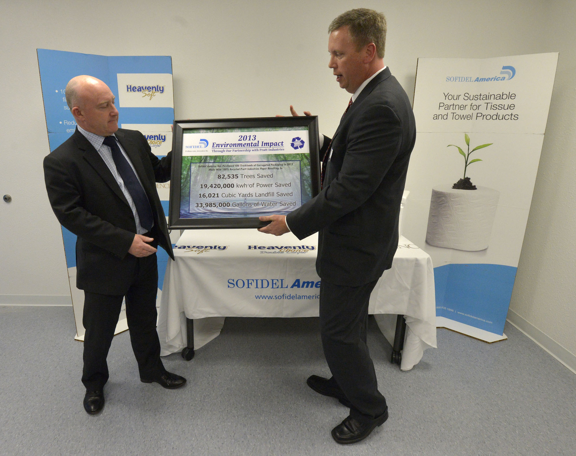 John Day, right, vice president and general manager with Pratt Industries, presents Tony Curtis, the CEO of Sofidel America, with a Sustainability Award on Wednesday.