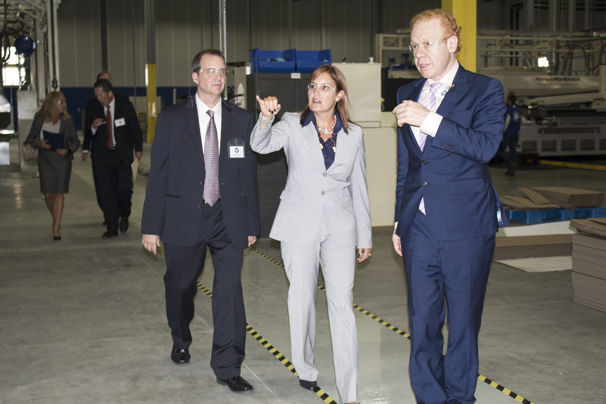 Company chairman Anthony Pratt shows Ohio Lt. Governor Mary Taylor around the new box making facility. They are joined by plant GM Craig Beaudoin.