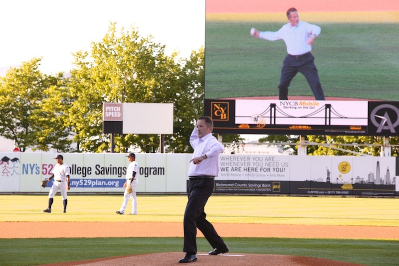 Pratt COO David Dennis throws out the first pitch